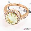 Кольцо позолота Круглый камень (цв.) в оправе камней, по 4 к. по сторонам