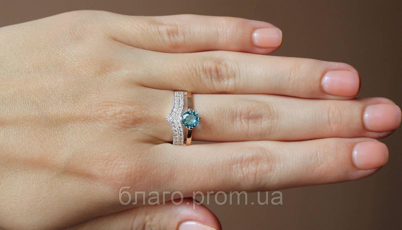 Серебряное кольцо с золотыми пластинами и камнями