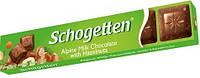 Молочный шоколад Schogetten  «With Hazelnuts»(с кусочками орехов) 33 г, фото 1