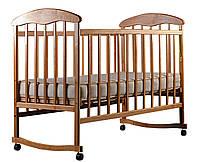 Детская кровать  ольха светлая с опускаемой боковиной, с качалкой на полозьях и съемными колесами, Наталка