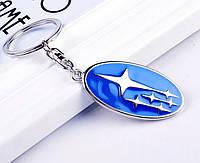 Брелок овальной формы с логотипом Subaru, хром/синий