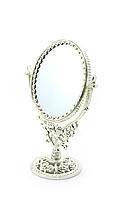 Настольное зеркало на ножке с узорами серебристое