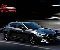 Mazda представила обновленную «трешку»
