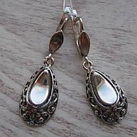 Оригинальные серебряные серьги с орнаментом