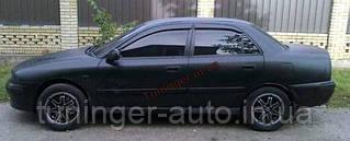 Ветровики, дефлекторы окон Mitsubishi Carisma 1998-2002 (Hic)