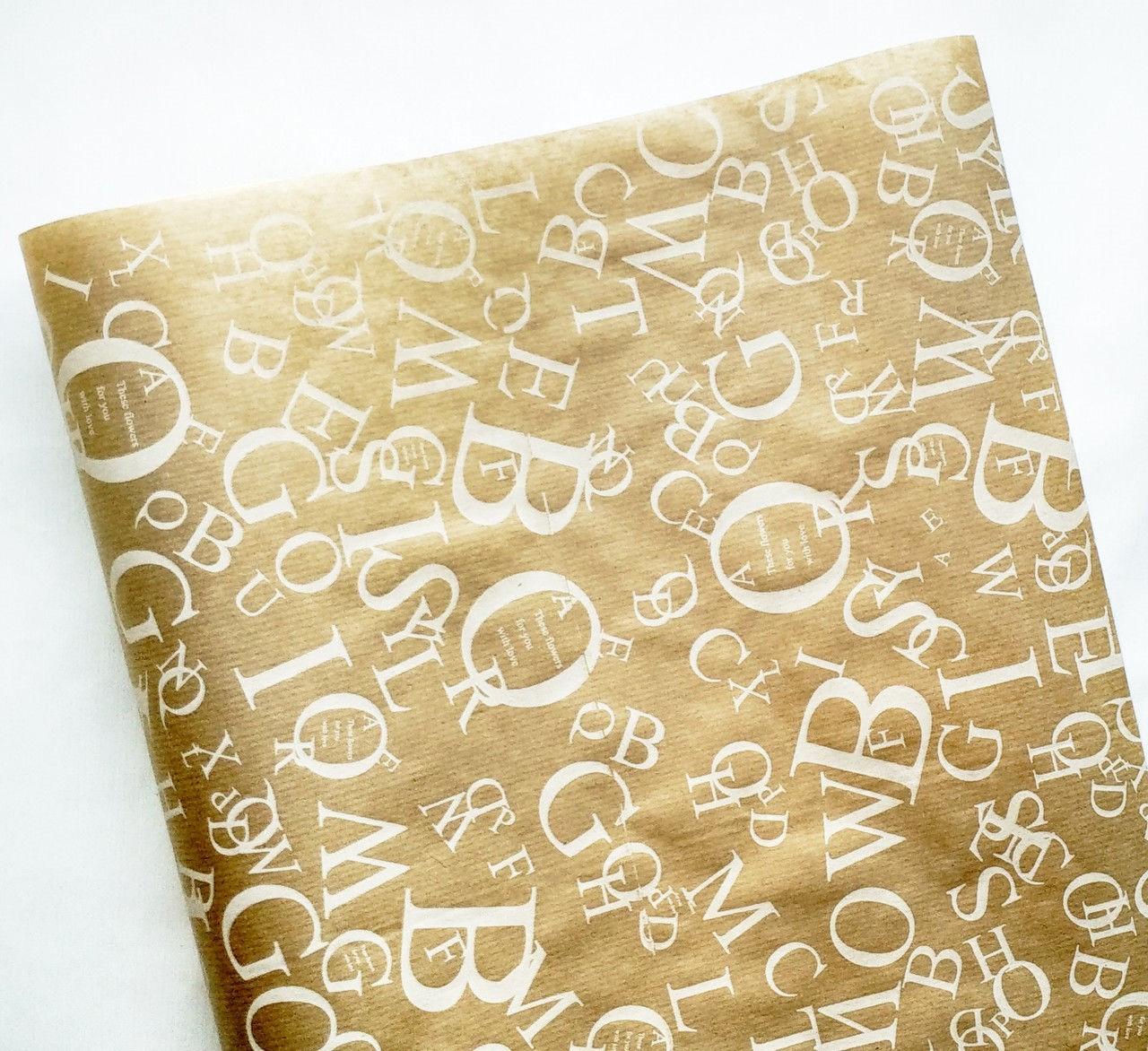 Бумага флористическая Буквы белые на крафте