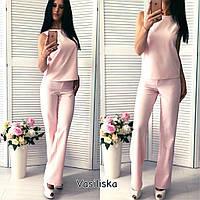 Стильный женский костюм - брюки и блуза, разные цвета