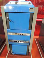 Пиролизный газогенераторный котел на твердом топливе  Atmos DC 24 RS площадь обогрева помещения до 240 м2
