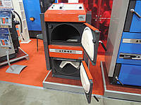 Отопительный котел пиролизный  на дровах ATMOS DC 70 GSX  площадь обогрева помещения до 700 м2