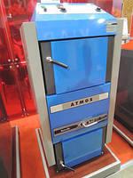Экономичный твердотопливный пиролизный котел ATMOS DC 40 SХ  площадь обогрева помещения до 400 м2