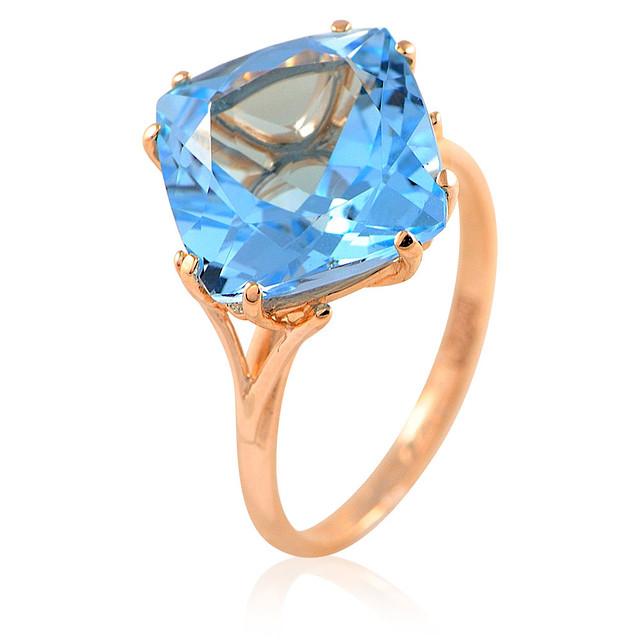 Золотое кольцо с огромным голубым топазом