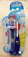 Детская зубная щетка с песочными часиками