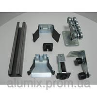 Комплект фурнитуры для откатных ворот ММЧ-5 до 450 кг с неоцинкованной шиной c металлическими роликами Алютех