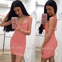 Платье с декольте и вырезами на спине