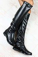 Женские кожаные сапоги на низком ходу сзади с заклёпками