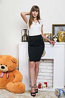 Элегантная облегающая черная юбка средней длинны