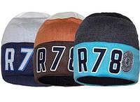 Детские демисезонные вязаные шапки двойные синего цвета.