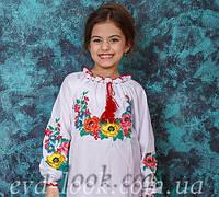Вишита блузка для дівчинки в школу.