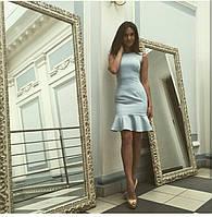 Платье из плательной ткани голубого цвета своланом внизу