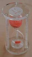 Песочные часы на стеклянной подставке
