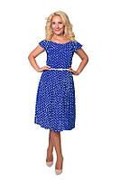 Элегантное платье синего цвета в горохи