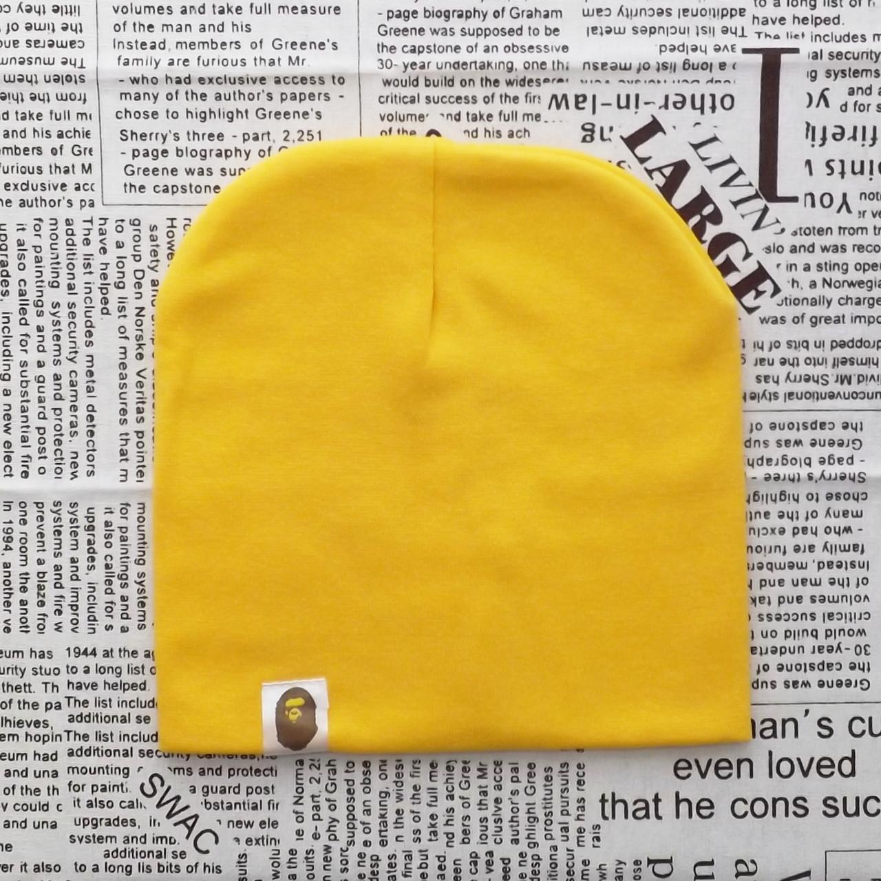 Демисезонная трикотажная шапка Варе насыщенно желтый