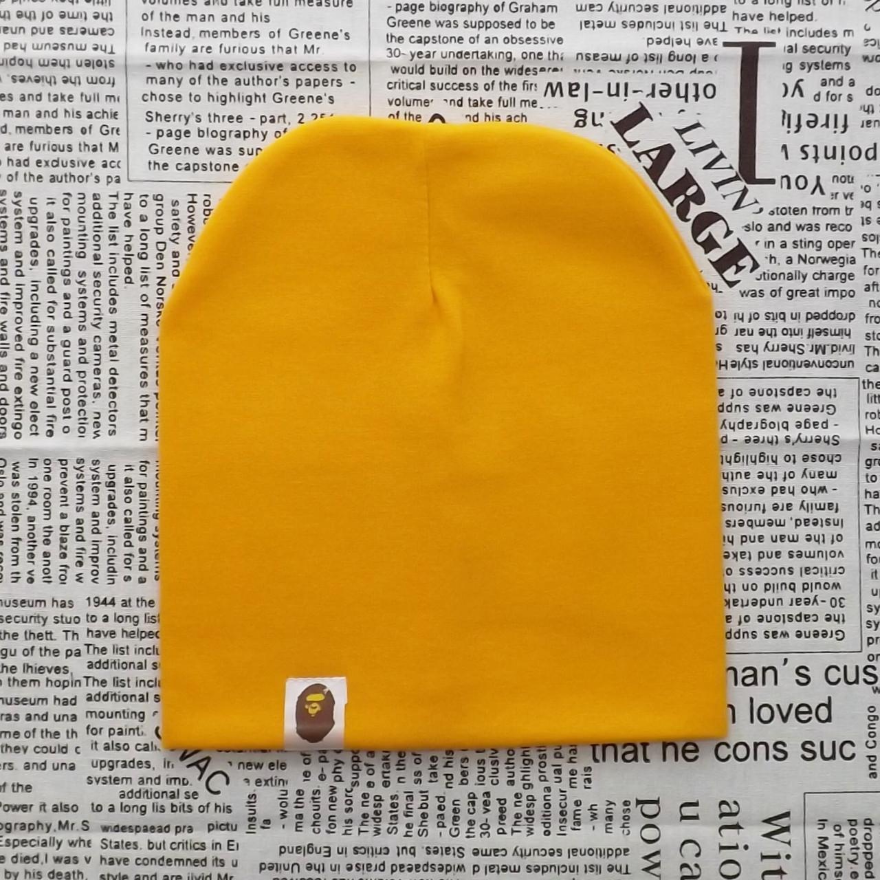 Демисезонная трикотажная шапка Варе янтарный