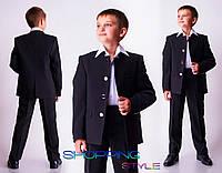 Элегантный строгий синий костюм для молодого юноши