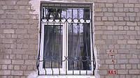 Решетки на окна с кованными элементами