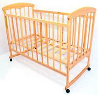 Детская кроватка-качалка из дерева на колесах Наталка