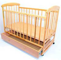 Деревянная кроватка-качалка на колесах с ящиком Наталка