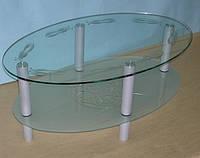 Овальный журнальный столик из стекла