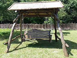 Садовые качели из дуба с камышевой крышей