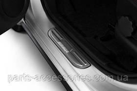 Mitsubishi Mirage 2014-15 накладки на дверные пороги передние новые оригинальные