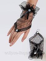 Перчатки черного цвета с рюшами