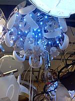 Потолочная люстра с пультом дистанционного управления и с диодной подсветкой.