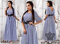 Летнее платье в пол в полоску, декорировано поясом и вырезом на спине.