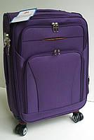 Чемодан дорожный четырехколесный  лиловый маленький 49х36х22 см