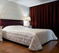 Кровать как центральный акцент спальной комнаты