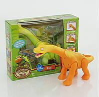 Динозавр на батарейках, музыка, свет, ходит в коробке 20*9*37 см