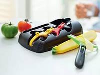 Овощечистка -одна ручка с тремя насадками.Набор Клик сэт Tupperware.