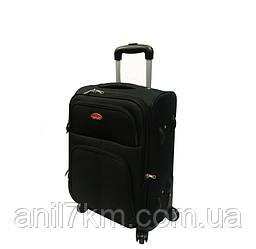 Малый дорожный чемодан на четырёх колёсах фирмы SUITCASE