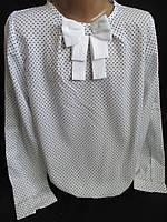 Белые блузы в горошек с белым бантом.