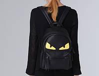 Кожаный рюкзак с желтыми глазами