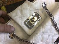Ремонт поворотного замка на женской сумке