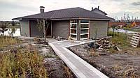 Дерев'яний будинок з сауною та літньою терасою