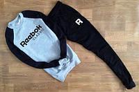 Спортивный костюм Reebok серое туловище, черные рукава и штаны, ф2751