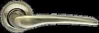Ручка дверная Capella LD40-1AB/SG-6 бронза/матовое золото (Armadillo)