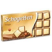 Шоколад молочно-білий Schogеtten Trilogia з лісовим горіхом 100 г