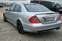 Спойлер сабля Mercedes W211 стиль AMG (PUR)